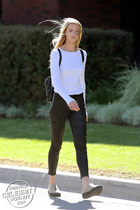 Model Abby Champion Fashions Tight Leather Pants in Los Angeles