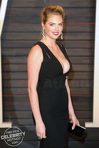 Kate Upton Wears Extreme Cleavage-Baring Victoria Beckham Maxi Dress