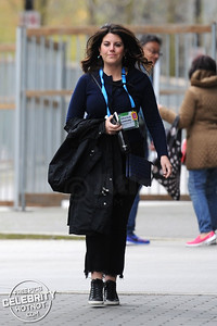 Monica Lewinsky is windswept as she smiles for the cameras heading to Ted Talks in Vancouver, Canada
