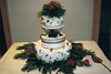 13  This Christmas wedding cake has red roses, pine boughs and gold leaves and beads to celebrate your special day.