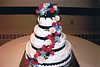 37   Four Tier cake with string work, Royal Blue Ribbon and fresh cascading flowers.