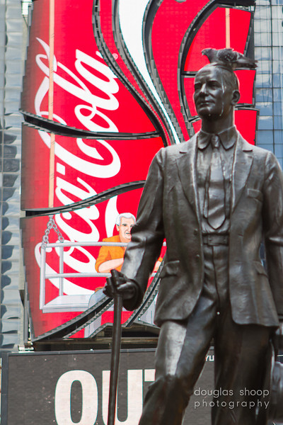 NYC Times Square  - Double whammy.  George Cohan getting crapped on in front of the shameless Coke.