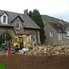Old extension demolished in a day - the pile of sandstone in the foreground is cut down to clad the new building