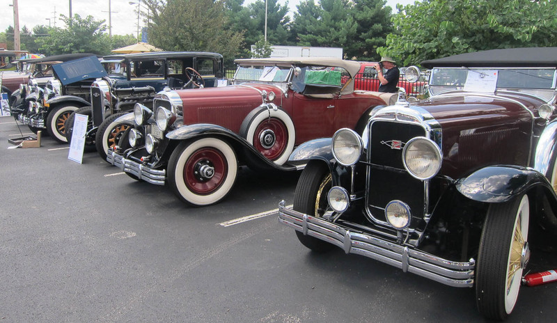 Photo showing all 4 wheels offered in 1929.  Car on left (50) has the basic wood wheel (came standard with the car).  Chassis (57) has the Artillery wood wheel option.  Roadster (44) has disc option.  Touring car (55X) has the wire wheel option.