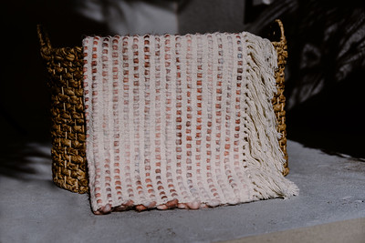 Textured Ivory Blanket with Pink Undertones