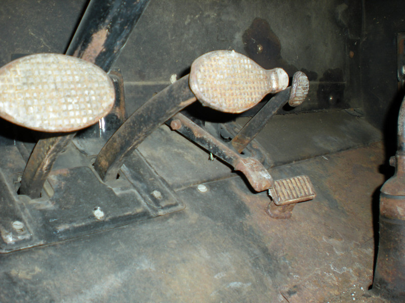 L to R - clutch, brake, gas, starter and foot rest - left hand drive cars