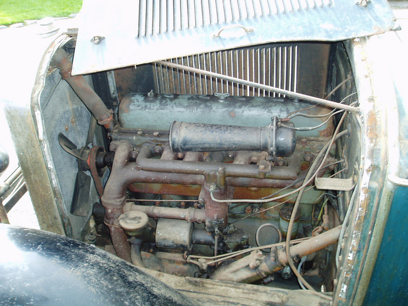 "29-25 - unrestored with approx. 25 K miles (sat in a barn from 1939-2006).  Note: likely original, red fan belt and radiator hose plus ""Lock-Roll Buick"" hose clamps.  Also, note paint colour on engine."