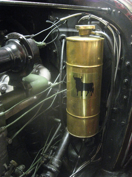Overflow tank on 29-44 McLaughlin Buick roadster.  Tank made in Spain.  Sealed system with customized screw-down radiator cap and water pump rebuilt with sealed bearings.