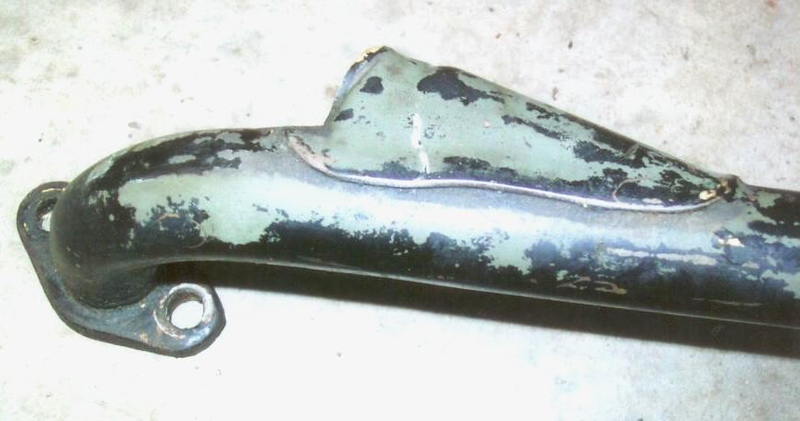 Original Water Return Pipe - confirming that it was orig. painted black after being manufactured and then painted engine green over the black after being installed on the engine (confirmed by the green overspray on the gen., fan and oil lines).