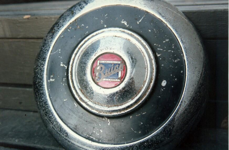 Early Canadian Side-mount hubcap