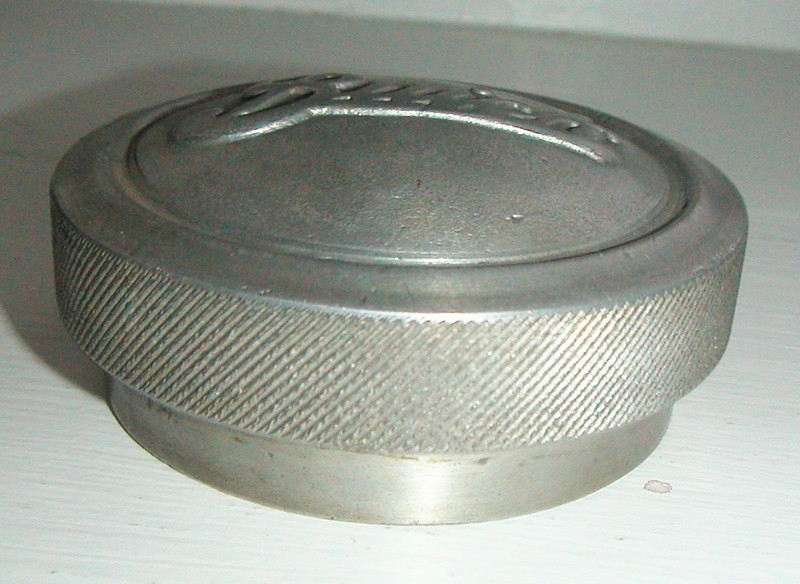 Early USA Hubcap (Script) with knurled edge (slightly smaller than stock Script caps).  Unknown if it's from Buick, one of the international suppliers, an after-market source, or the product of some very resourceful guy with his own casting and machine shop?