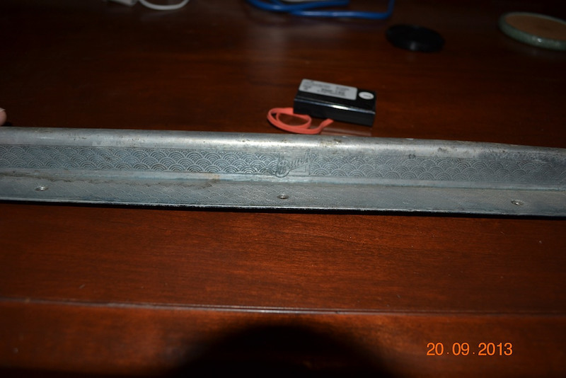 46S - Door Sills:  Sill is 31&1/8 inches long with the bottom flat part being 3/4 inch wide at the ends and 1&1/8 inch wide at the middle.  It is 1 inch tall and 1/2 inch wide at the top.  (By Tom Wallace)
