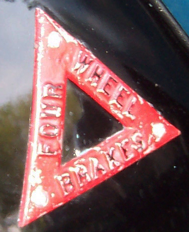 4 wheel Brake Triangle on left rear fender of early Buick.  Sharp eyed Norm McKendry spotted this on a piece of 1929 McLaughlin (Canadian) literature.  Did Buick ever use these 4 wheel brake triangles on 29 Buicks ?