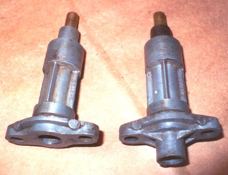 Speedo Driven Gear Housing:  R. Kearns noticed 2 different versions with the non-shouldered one (left) the most common.  Shoulder would have given speedo cable more support.  Casting number is the same.