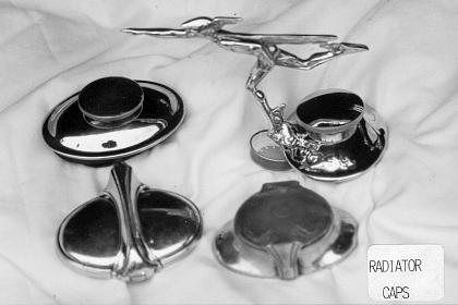 Top:  Left: Screw-down cap; Right: Mercury Boy cap<br /> Bottom: Left: Toilet seat cap; Right: Aftermarket cap