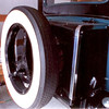 Spare Tire Set-Up on a Model 29-27. Spare is mounted behind the trunk and is actually attached to the swing-down part of the trunk. This set-up was on the car in 1965.  Trunk lid is pretty heavy when opened.