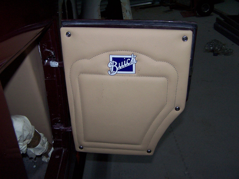 29-44X - Restoration Upholstery - Golf club door (note:  Buick logo is not original)