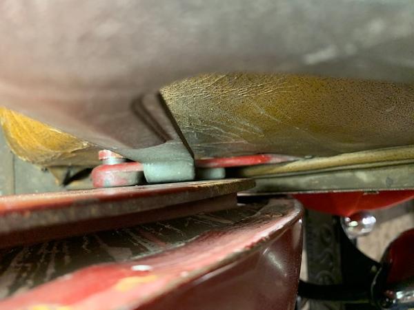 29-44 - Rumble seat hinge at bottom of rumble seat handle.