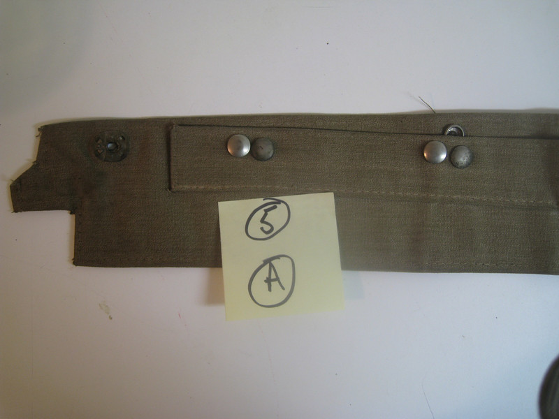 29-44 - Side Curtains:  left side top, from outside.  Note: extra flap, folded up.  (Note:  may have extra snaps).