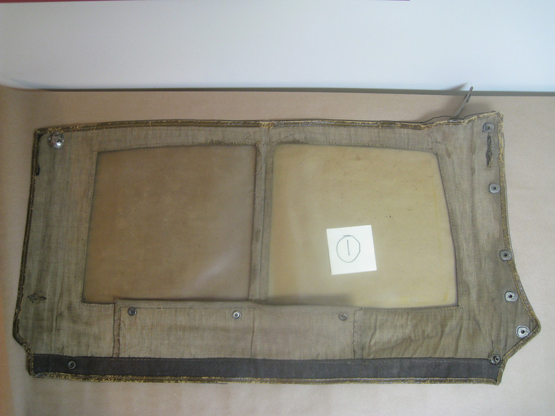 29-44 - Side Curtains:  left side, front from inside (with flap that goes over door folded-up)