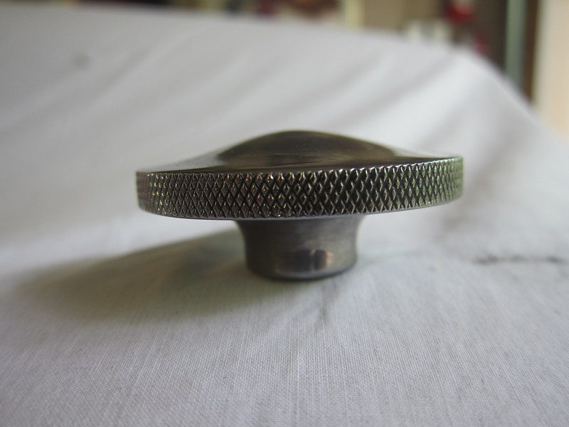 "Bottom knurled nut in open car W/S frame.  This nut is 1&63/64"" in diam.  Where it screws into stud is 47/64"" and overall height to top of crown is 7/8""."