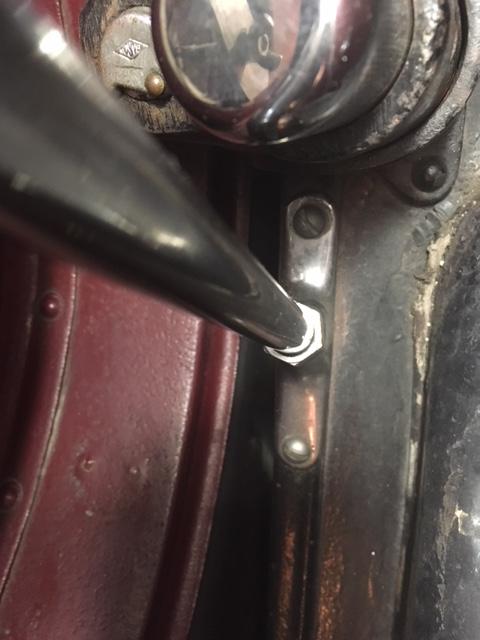 Bracket holding sidemount hardware to wheel well / fender