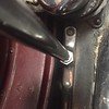 Bracket holding sidemount hardware to wheel well / fender