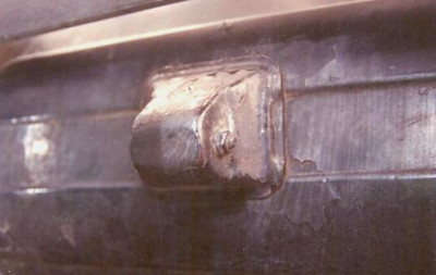 Special Cap used to cover rear spare bracket ends, installed at factory on side-mounted cars