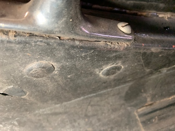 Sidemount rod foot showing carriage bolts that go into bracket behind sheet metal