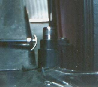 Side-Mount Lock in place - see horse-shoe hold down on fender and security cap, in place
