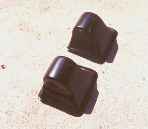 Special Caps used to cover rear spare bracket ends, installed at factory on side-mounted cars