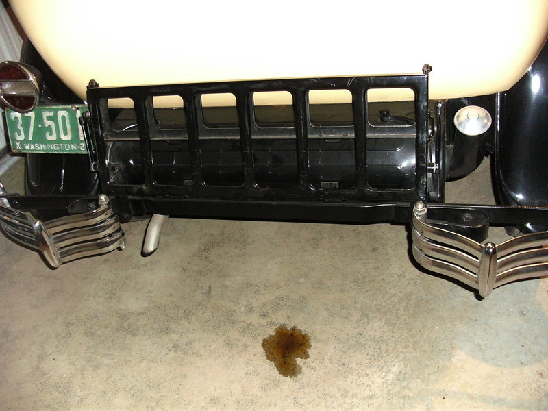 Trunk rack on SINGLE side-mounted 29-27.  Note:  Split bumper (vs. full rear bumper on double side-mounted cars) and no covers on go over the rear mounted spare tire bracket holders that poke through the gas tank cover.