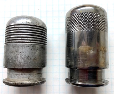 Sidemount Lock Caps (cover the special bolt)  Left is, I believe, a 1930 cover and right a 1929 cover.