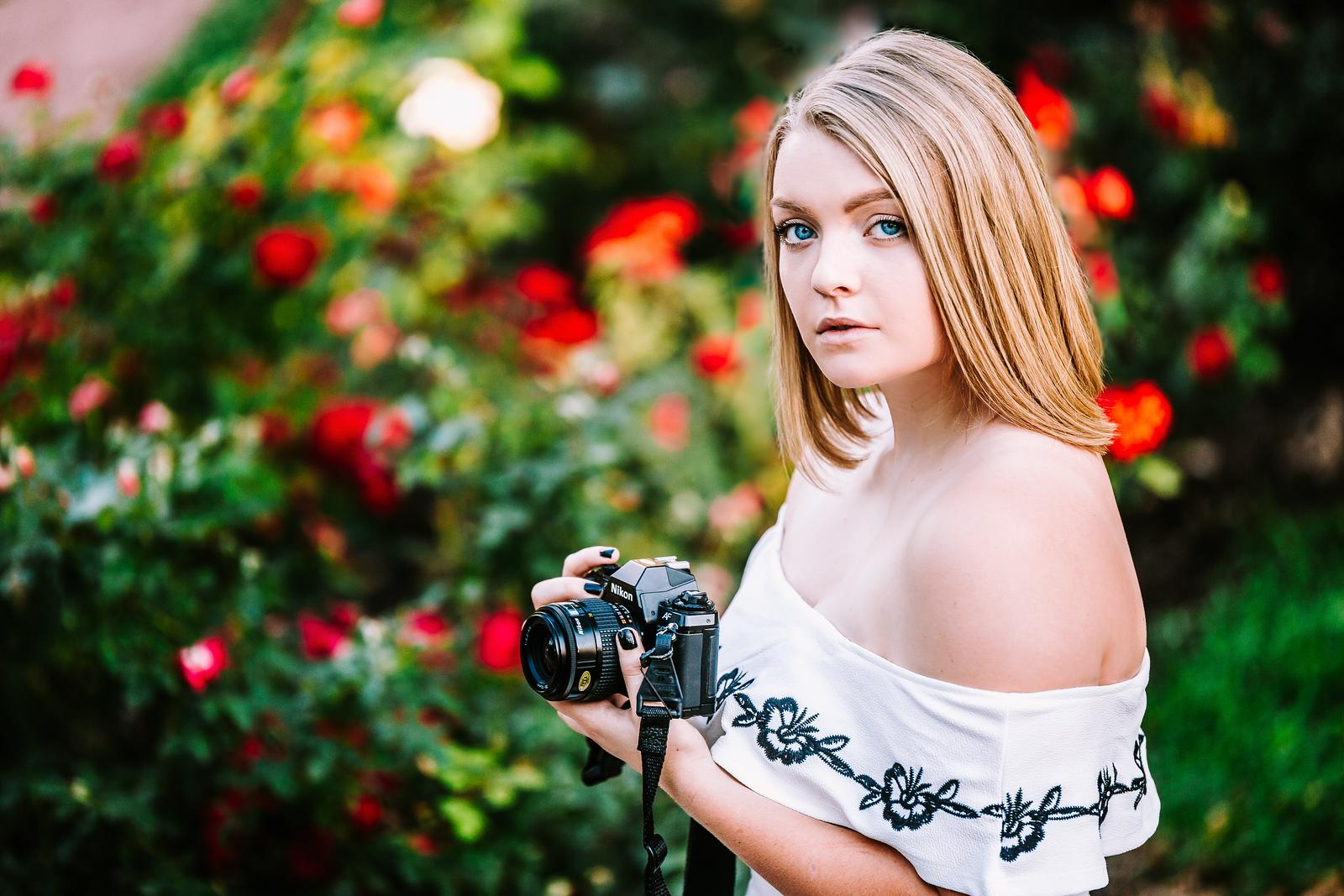 girl holding camera