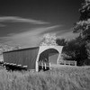 Built in 1884 by Benton Jones, the Hogback Covered Bridge measures 97 feet, and is in its original location in a valley north of Winterset. Hogback gets its name from the limestone ridge which forms the west end of the valley. It was renovated in 1992 at a cost of $118,810.<br /> LATITUDE: 41.386480750341185