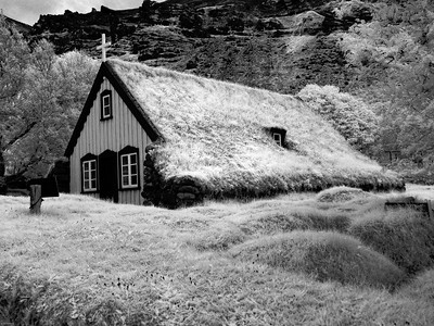 Hofskirkja Church, 1884, Hof Iceland, stone walls & slab roof turf covered.