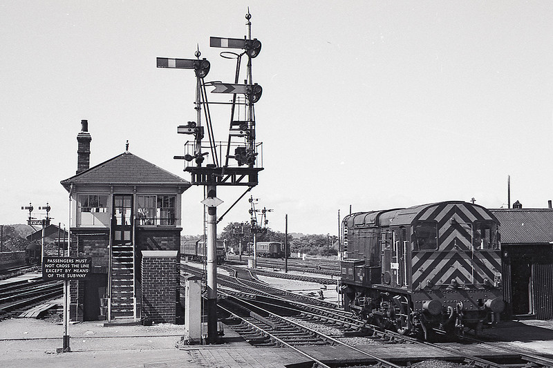 July 1968:  Standing next to Westbury Middle Box is D3002. The Hymek lurking behind the signal is actually in the Carriage Siding between the lines running into Platforms 3 & 4