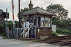 28th Sep 1985:   The delightful LBSCR crossing box in the hamlet of Woodgate, where the A29 to Bognor Regis crosses the coastal line not far from Barnham.