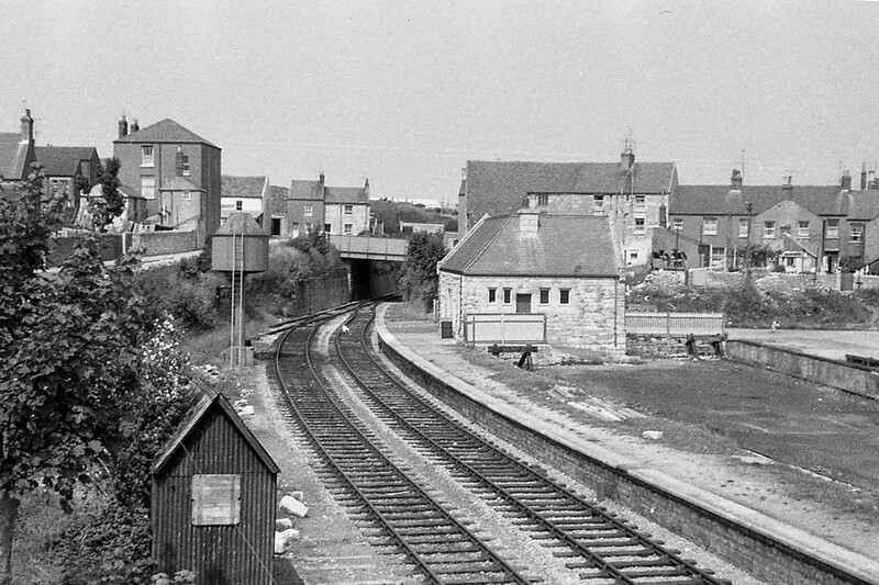 September 1962:  Easton Station on Portland Bill had closed on the 3rd March 1952 but freight continued until 1865.  The line continued under the bridge to a stone quarry.  A  small engine shed had stood to the left of the water tower and the platform canopy had been demolished.