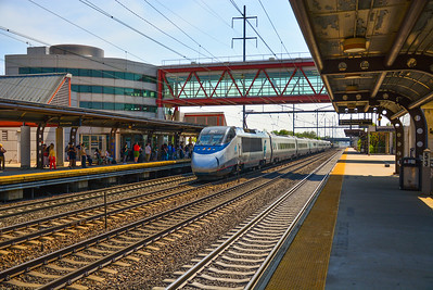 Eastbound Acela Express racing past Hamilton