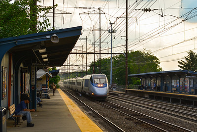 Eastbound Acela Express Rockets past Metuchen Station