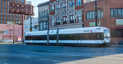 Southbound Light Rail train gliding along Broad Street