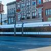 Southbound Light Rail train gliding along Broad Street