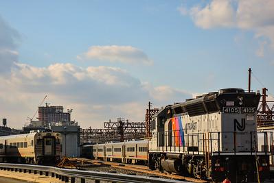 A Diesel Locomotive & Cab Car at Hoboken