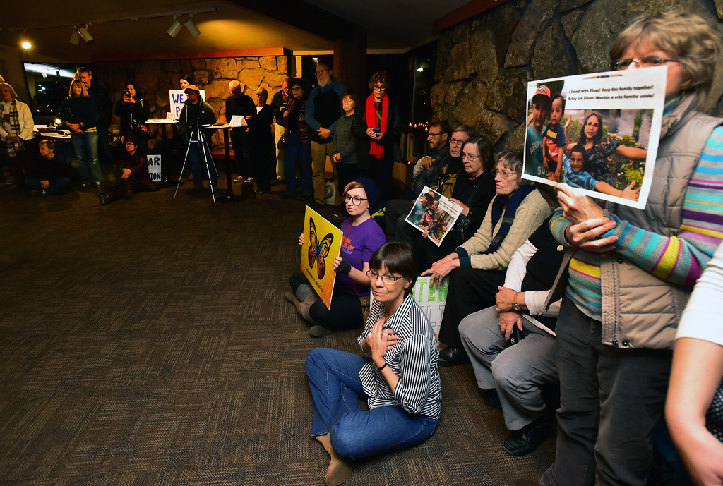 . People at the Unitarian Universalist Church of Boulder listen as Ingrid Encalada Latorre, she recalls her husband\'s call to tell he had been detained by ICE agents on Thursday. The church, where Encalada Latorre has been taking sanctuary, held a rally in support of the family.  Paul Aiken Staff Photographer Jan 11 2018.