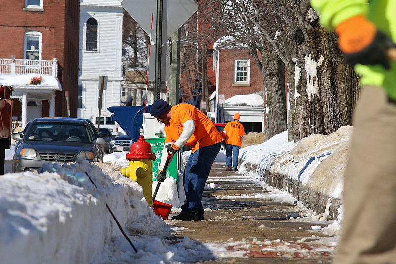 Inmates from MCI Shirley were brought out to Fitchburg to help the DPW on Tuesday. They were caught shoveling out the Upper Common in the city.  SENTINEL & ENTERPRISE/JOHN LOVE