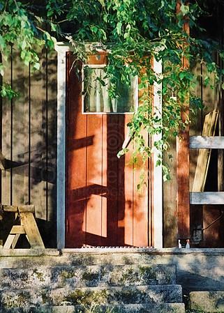 Red Sauna Door (Warm and Welcoming)
