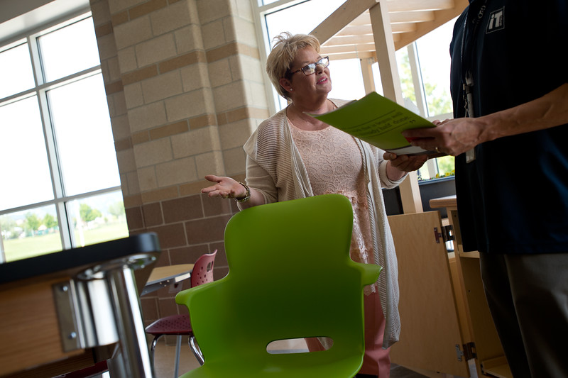 "Karen Volner, a national business development director with Business Interiors by Staples, talks with Julius Reinante about ethos chairs for classrooms designed by Haskell during Innovate@BVSD at Monarch High School in Louisville on Wednesday. <br /> For more photos go to  <a href=""http://www.dailycamera.com"">http://www.dailycamera.com</a><br /> (Autumn Parry/Staff Photographer)<br /> June 8, 2016"