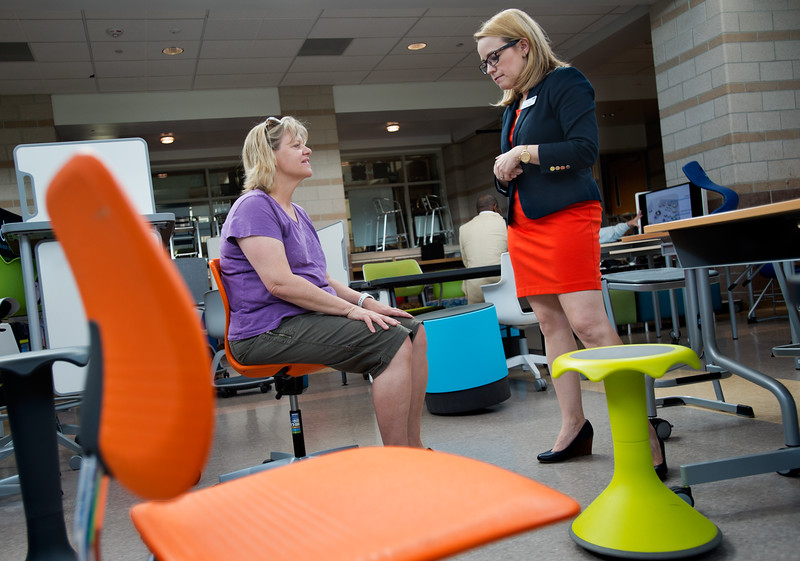 "Sharon Troxell, a kindergarten teacher with Emerald Elementary, tries out a chair designed OfficeScapes as she talks with representative Christine DeBrot, during Innovate@BVSD at Monarch High School in Louisville on Wednesday. <br /> For more photos go to  <a href=""http://www.dailycamera.com"">http://www.dailycamera.com</a><br /> (Autumn Parry/Staff Photographer)<br /> June 8, 2016"