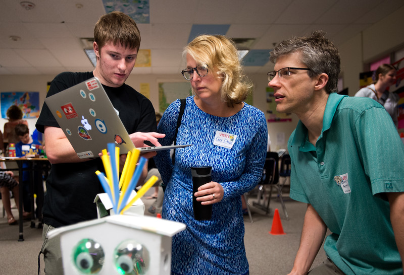 "Student engineer Rhett Sandal (left), from the Innovation Center of SVVSD, teaches Cece Davis, an assistant principal at Summit Middle Charter School, and Chris Torrence, a STEM instructor for Summit Middle Charter School, about a robot named Bibli, created by Robauto, during Innovate@BVSD at Monarch High School in Louisville on Wednesday. <br /> For more photos go to  <a href=""http://www.dailycamera.com"">http://www.dailycamera.com</a><br /> (Autumn Parry/Staff Photographer)<br /> June 8, 2016"